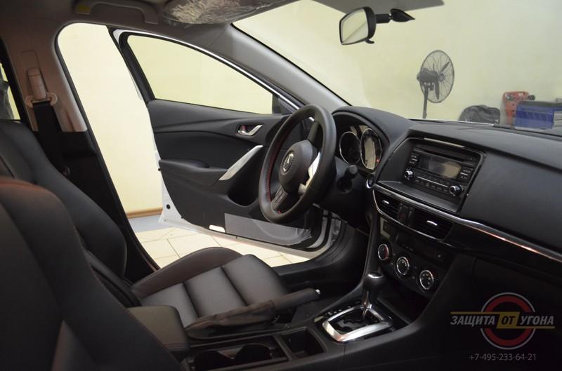 Перетяжка салона эко-кожей на Mazda 6