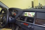 Цифровое телевидение и мониторы на подголовники в BMW X5